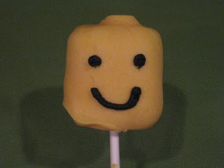 smiling lego minifigure marshmallow cake pop