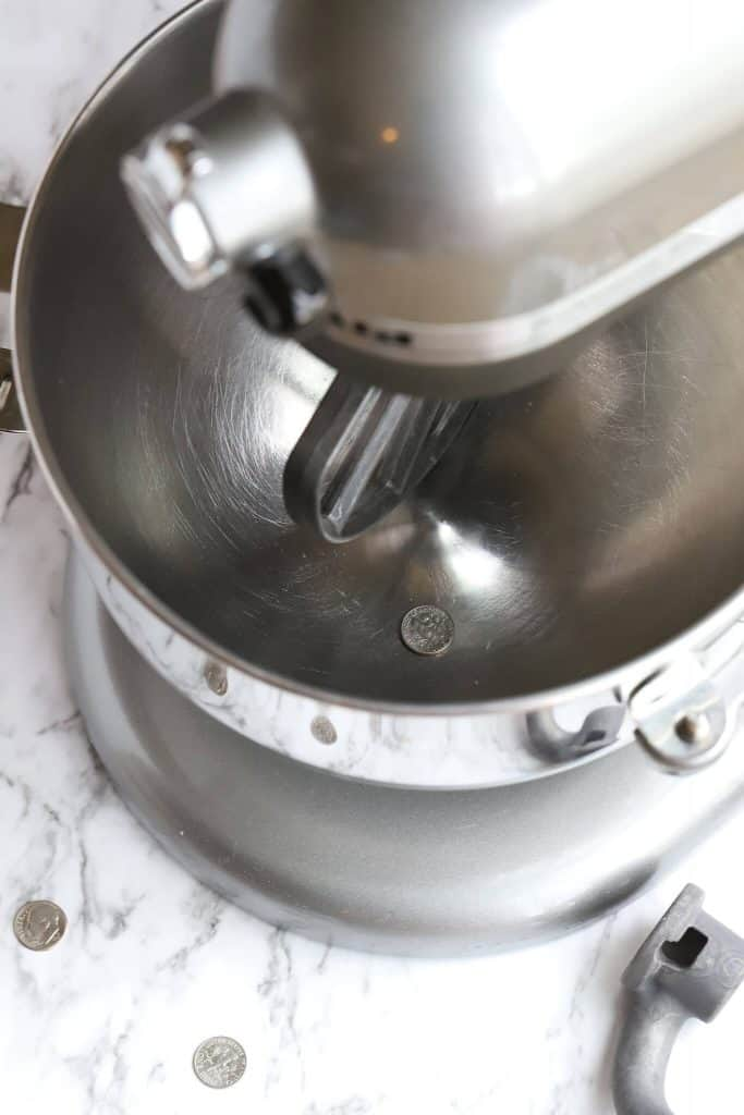 Overhead photo of Kitchenaid professional mixer with dimes available for dime test for kitchenaid mixer
