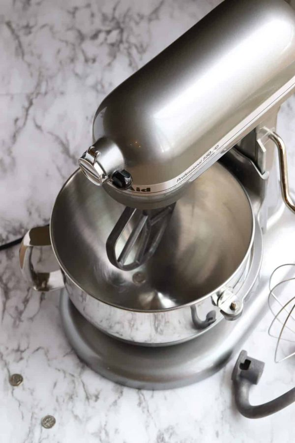 Kitchenaid mixer showing dime in bowl for calibration test