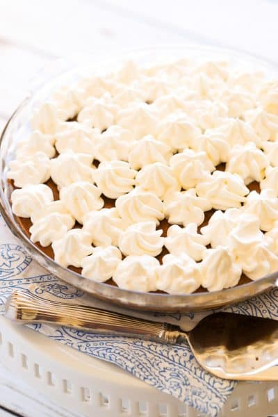 Chocolate pudding pie with piped whipped cream topping