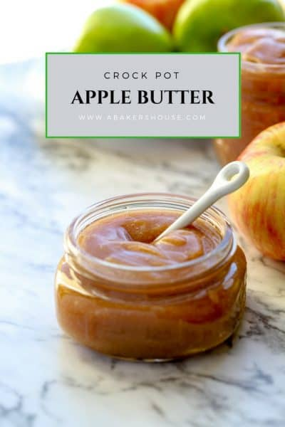 Crock pot apple butter in a glass jar with a white small spoon Pin photo