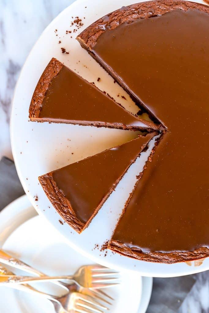Overhead slices of flourless chocolate cake with ganache