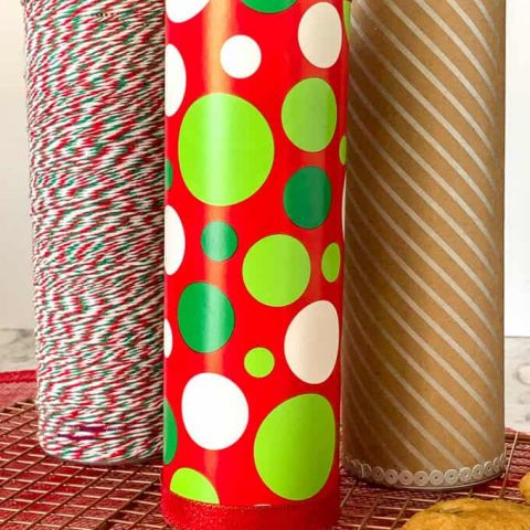 Creative Gift Packaging for Cookies using a Pringles Can. Three decorated cans.