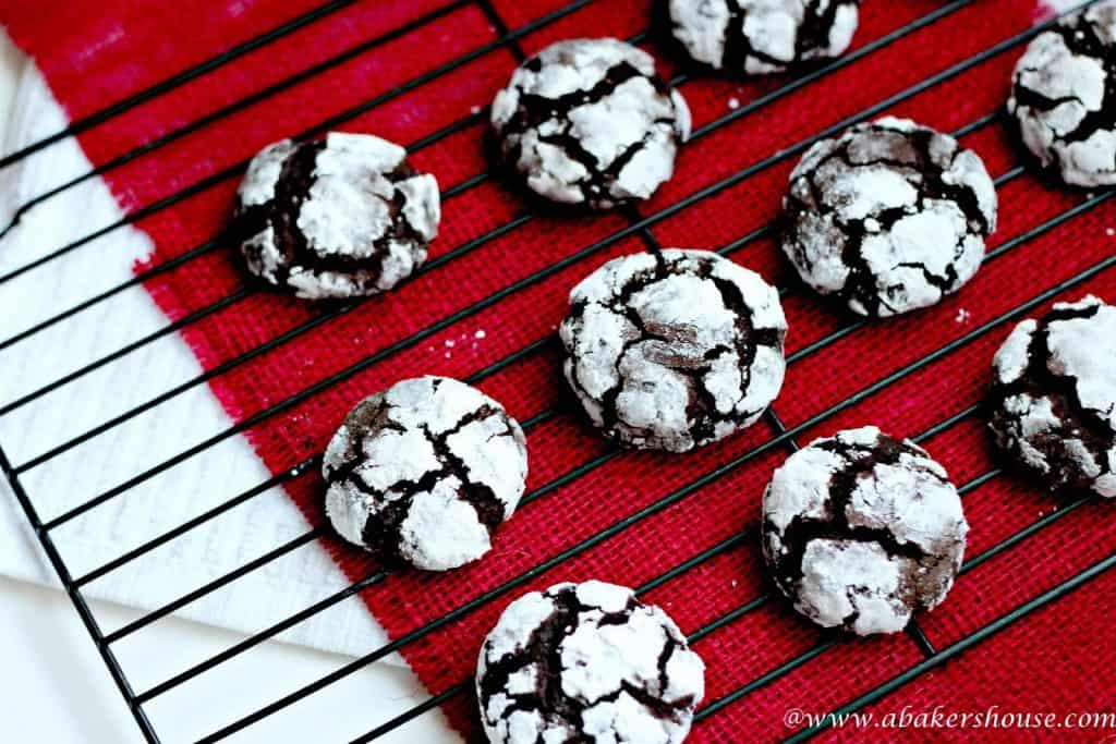 Coffee Chocolate Crinkle Cookies on wire rack with red napkin