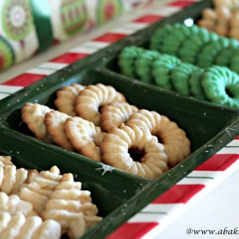 Christmas Spritz Cookies in the shape of trees and wreaths