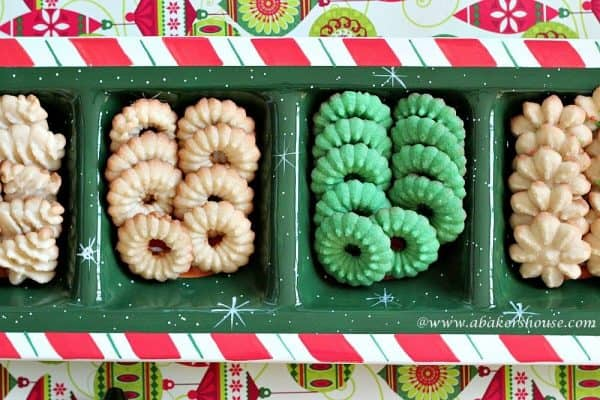 Christmas Spritz cookies in the shape of wreaths in tan and green colors