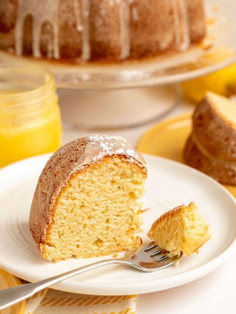 slice of gluten free lemon cake with piece on fork