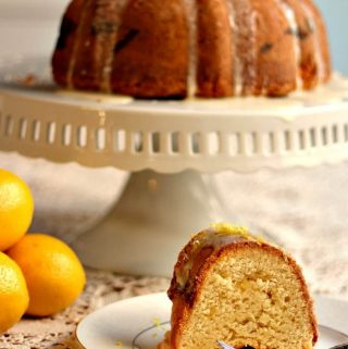 Lemon Bundt cake with a slice of cake on a white plate