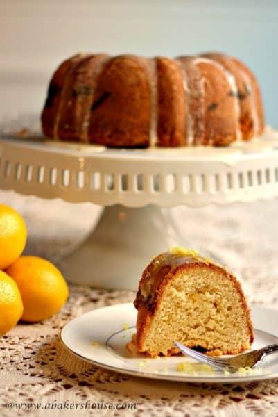 Lemon Bundt cake with a slice of cake on a white plate