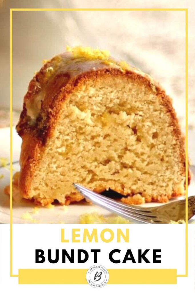 close up of one slice of lemon bundt cake with fork