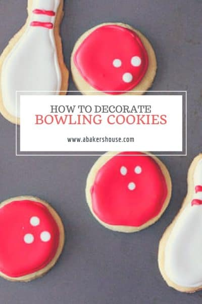 bowling cookies decorated in white and red royal icing with text title overlay
