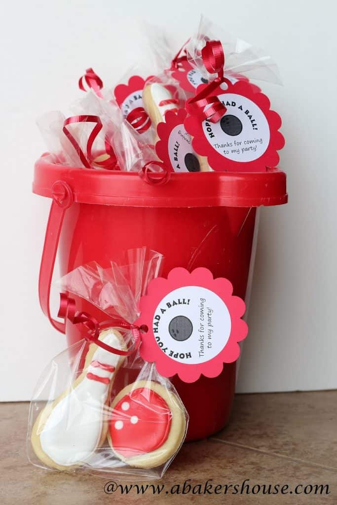 Bowling party favors in a red bucket ready for bowling themed party
