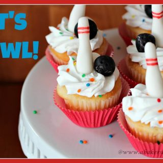 Cupcakes decorated with fondant bowling pins and balls