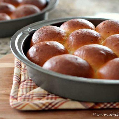 Homemade potato rolls in a metal pan