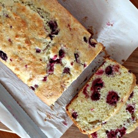 overhead photo of sliced raspberry quick bread
