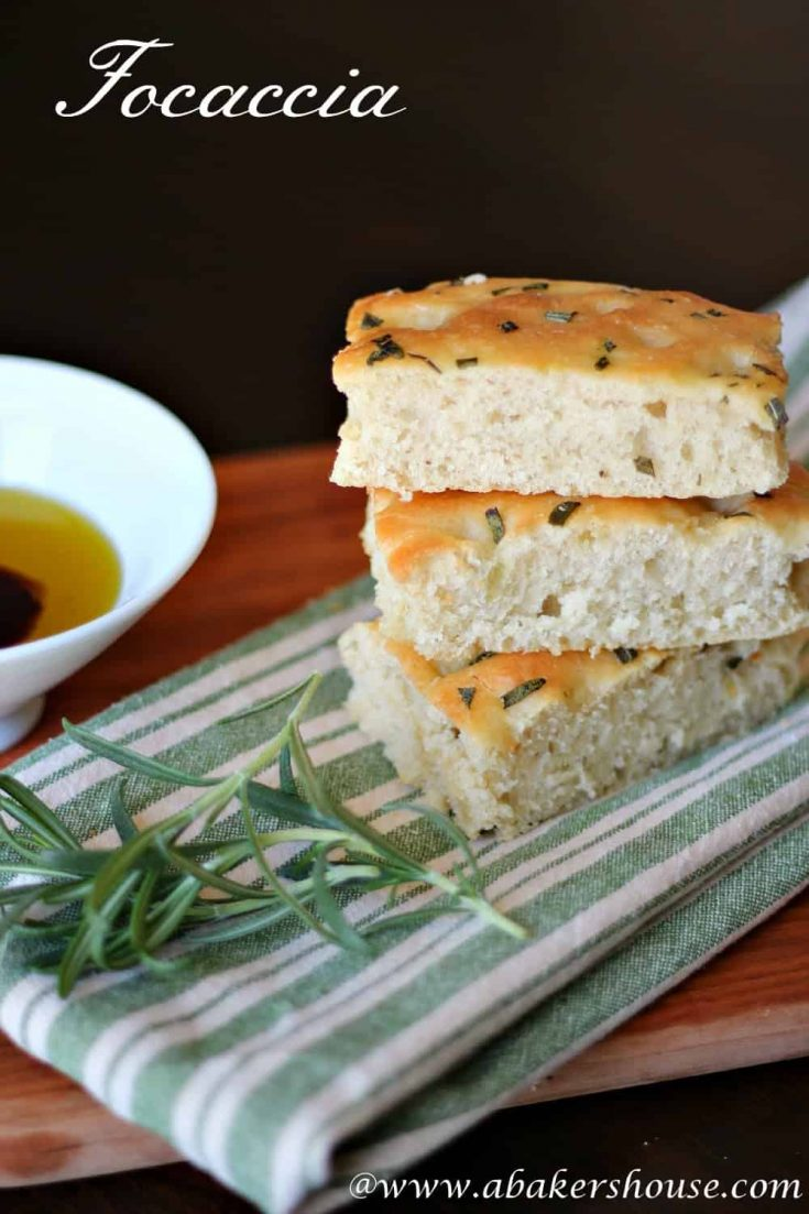 Basic focaccia is an easy to make homemade bread. Add different herbs to create your own flavors. #abakershouse #focaccia #italian #breadrecipe #easybreadrecipe