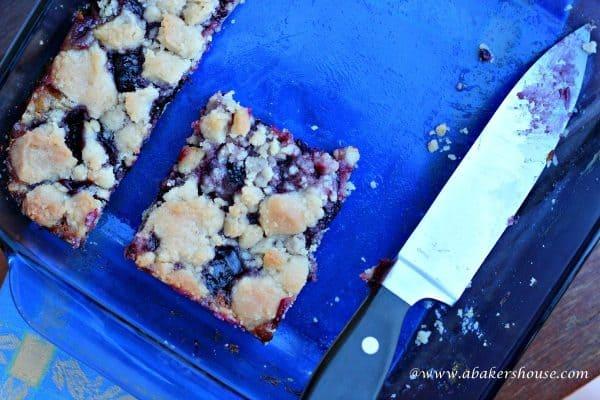 cut blueberry lemon squares in a blue pan
