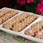Spritz flower cookies on a white tray