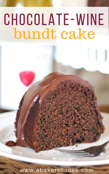 Slice of chocolate wine bundt cake on white plate with platter in background