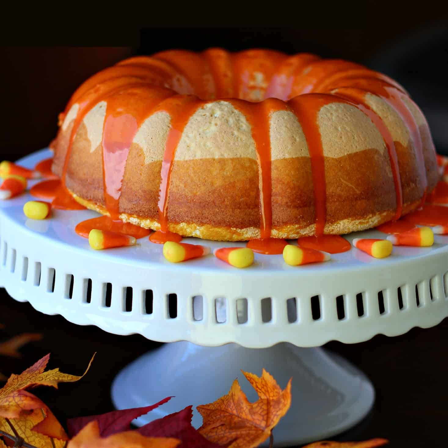 Candy Corn Bundt cake on a white cake platter
