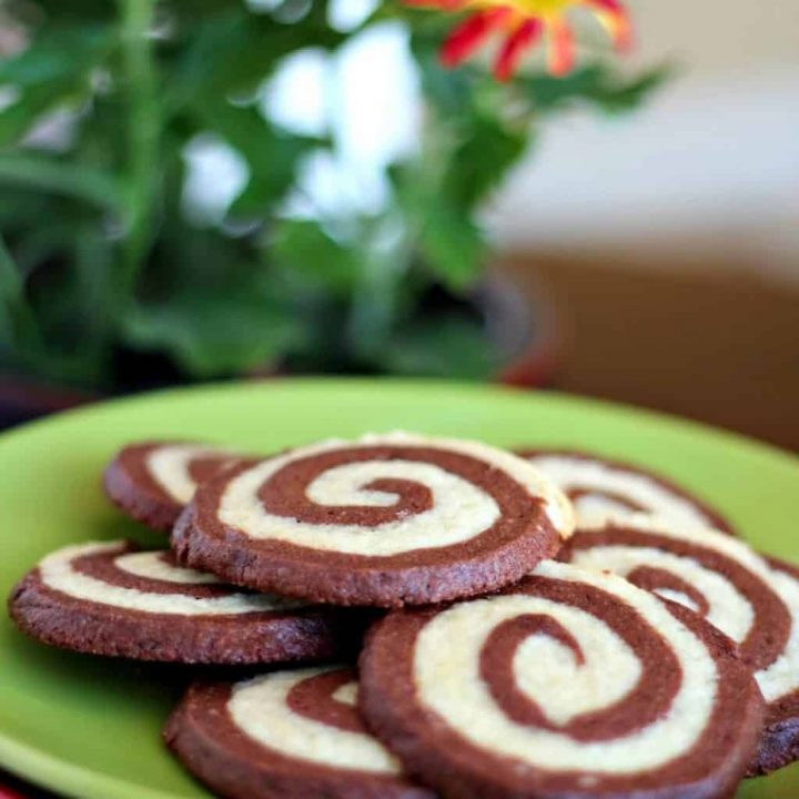 espresso pinwheel cookies on a green plate