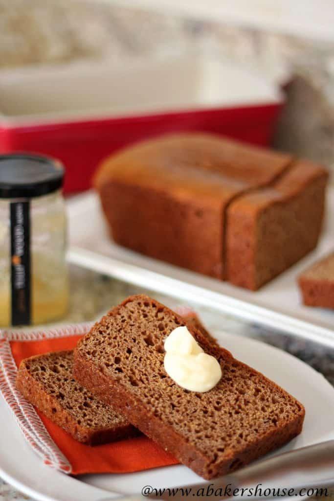 Honey Spice Cake sliced with honey butter on white plate