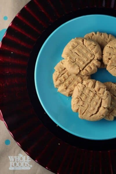 plate of dairy free peanut butter cookies overhead view on blue plate and red plate