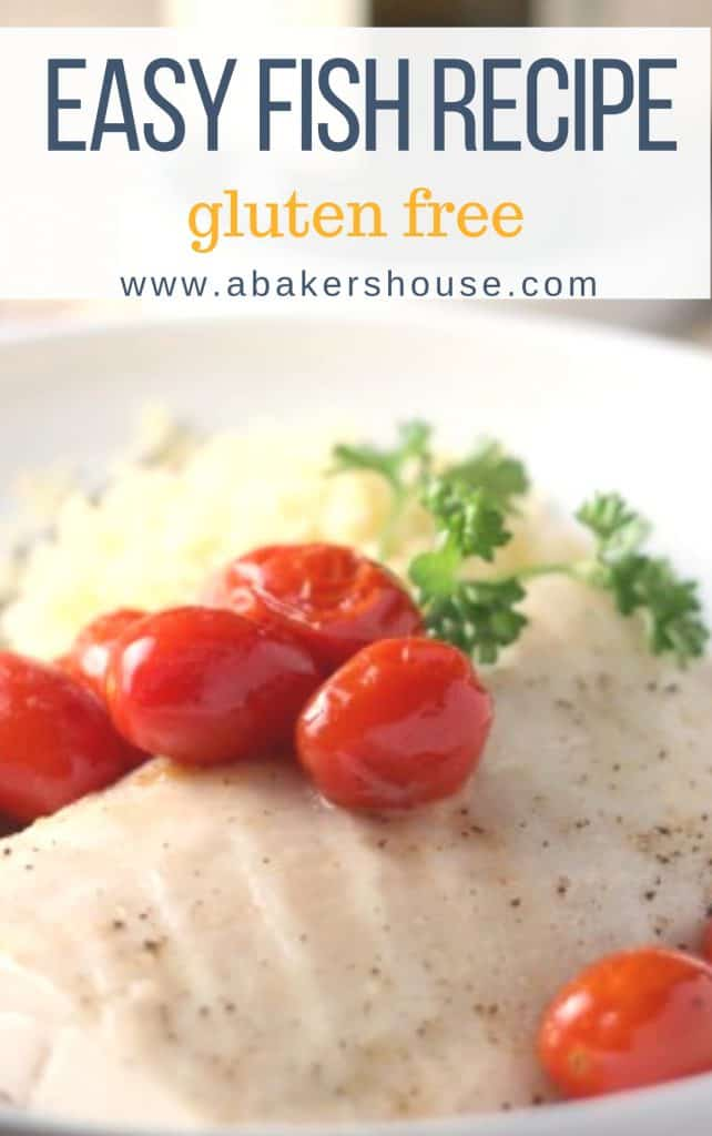 white fish with roasted tomatoes and parsley on a white plate