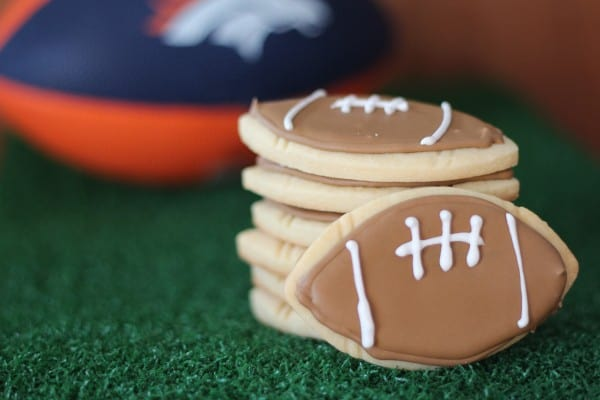 football cookies sugar cookies decorated with brown and white royal icing