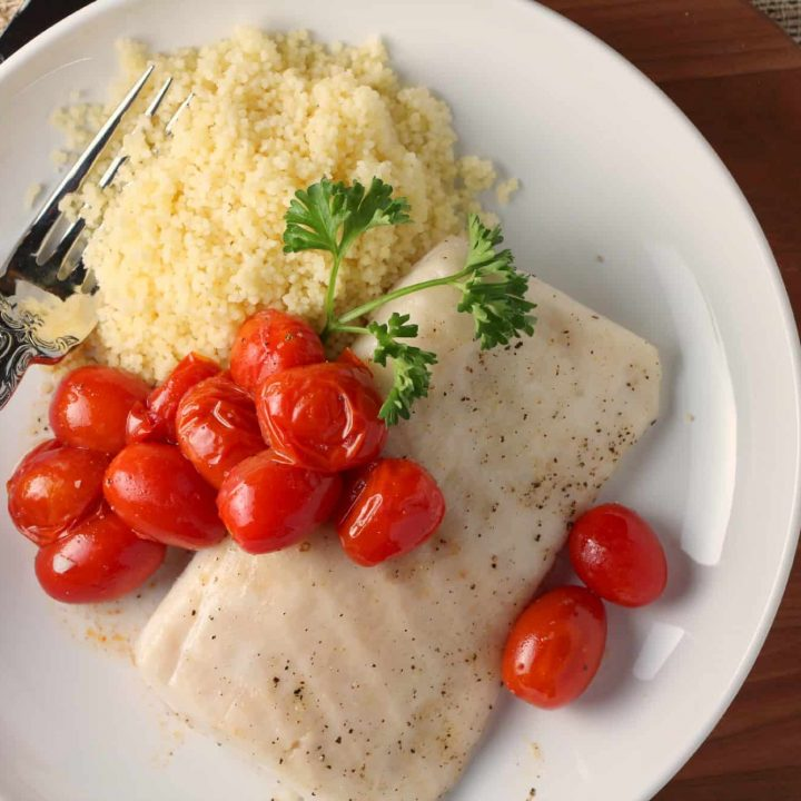 Oven roasted Paiche and Cherry Tomatoes