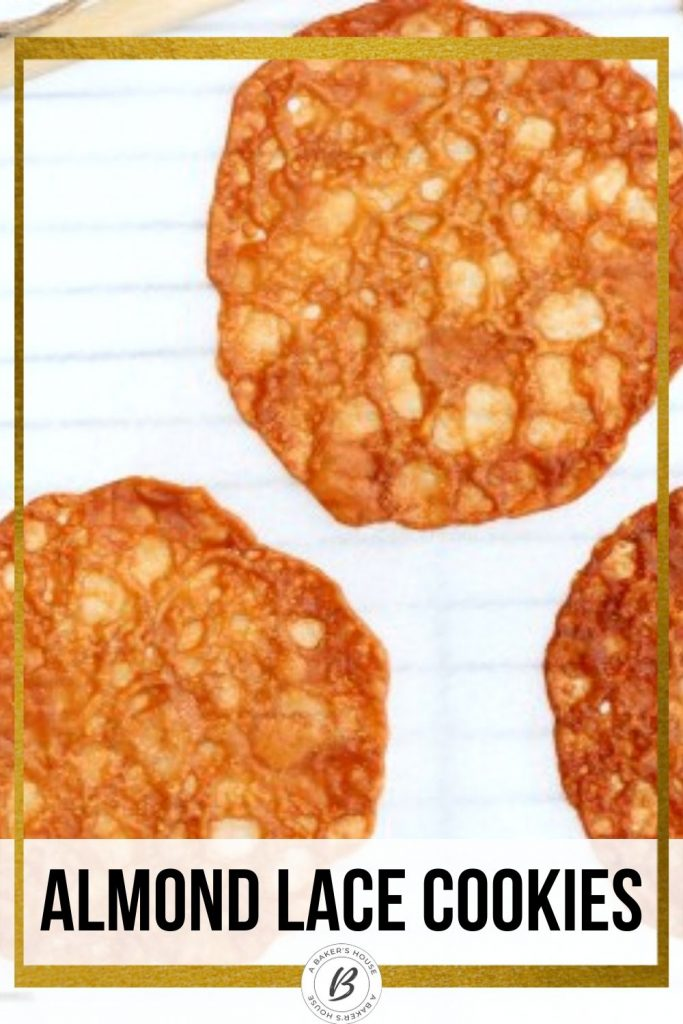three almond lace cookies on parchment paper