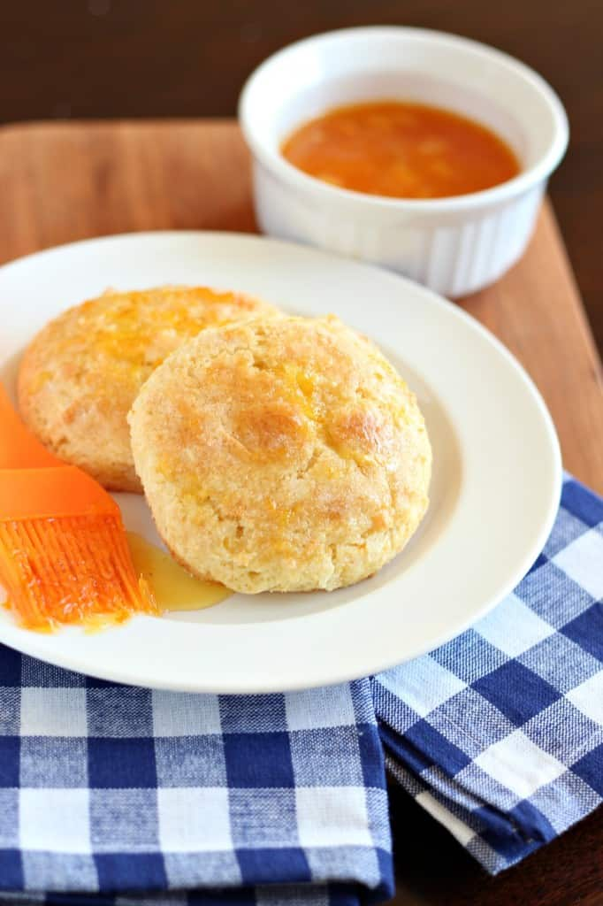 orange marmalade scones on white plate with blue checkered napkin