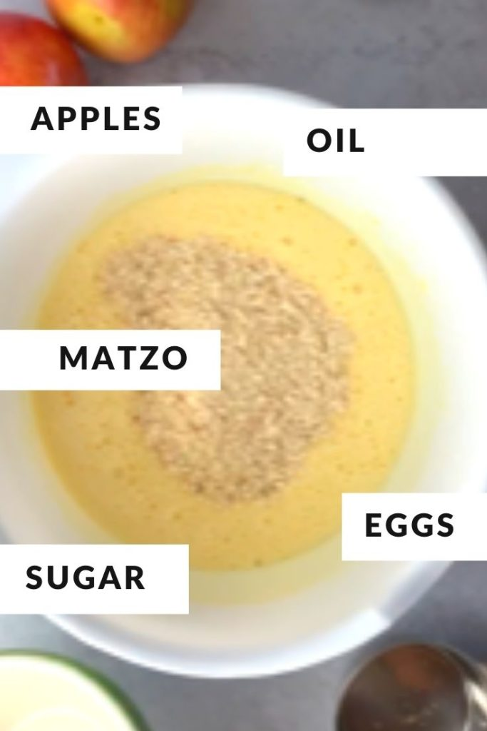 cake batter ingredients in a white bowl labeled as matzo, oil, eggs and sugar