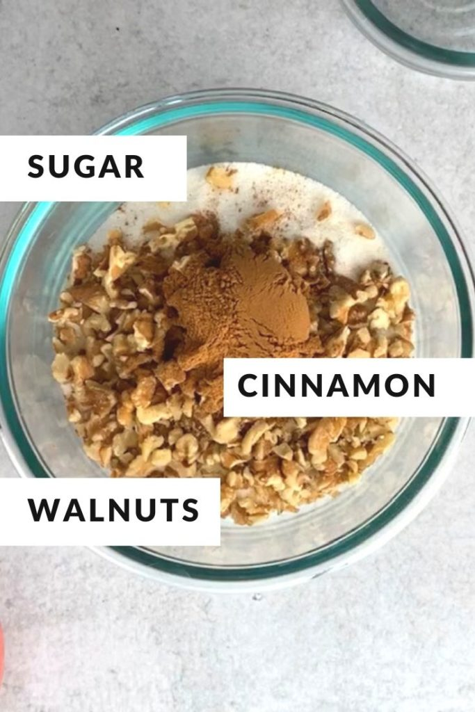 ingredients of sugar, cinnamon, walnuts in glass bowl