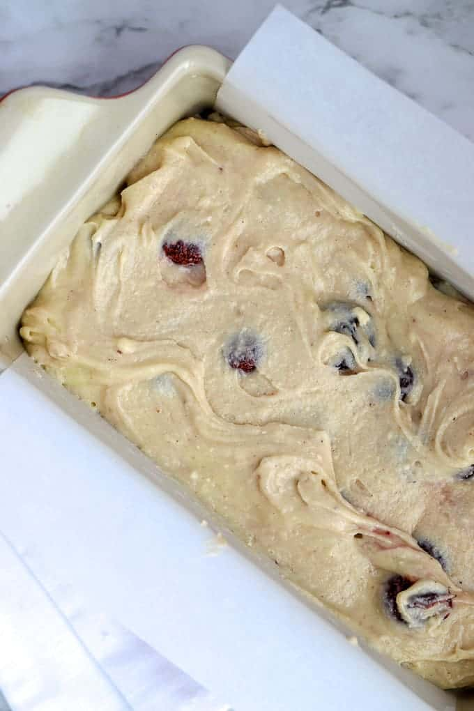 Batter for gluten free cherry quick bread in loaf pan before baking