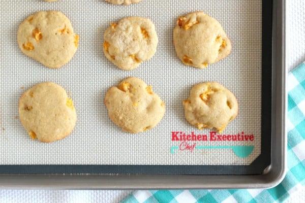 six nectarine drop cookies on baking sheet