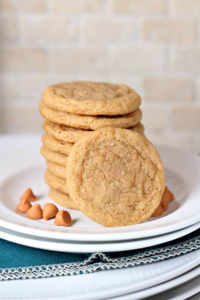 eight butterscotch cookies in a stack with one leaning in front