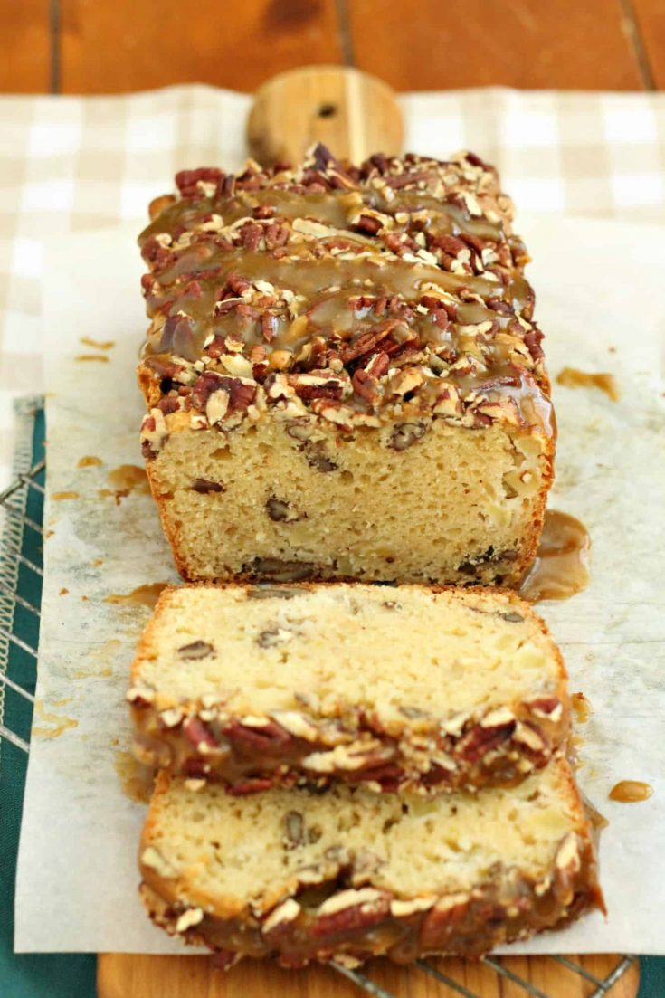 This quick bread is loaded with flavor. Praline apple bread has plenty of apples throughout each slice, and you won't want to miss the praline sauce on top of this quickbread. It is simple and easy to make yet you'll find yourself creating reasons to make it for other dishes too. #abakershouse #applebread #pralinesauce #pralines #quickbread #homemadebread