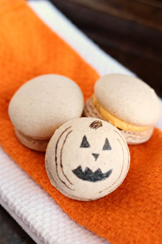 pumkin jackolantern macaron on orange napkin