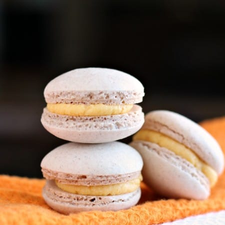 Stack of three pumpkin macarons
