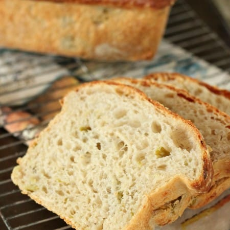 sliced hatch chile bread with loaf in background