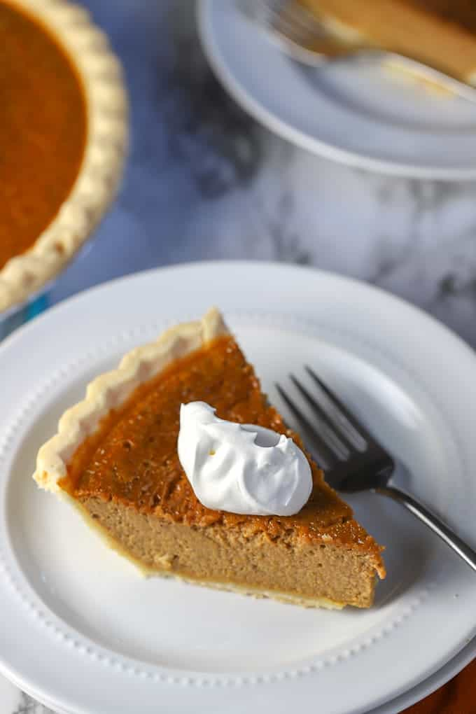 gluten free pumpkin pie slice with whipped cream