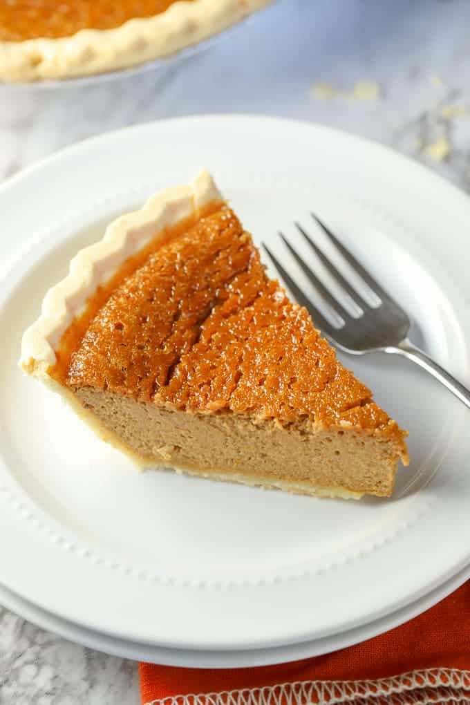 Gluten Free Pumpkin Pie comes together easily with a frozen, store bought crust and an easy pumpkin pie filling #abakershouse #pumpkin #pie #Thanksgiving #glutenfree