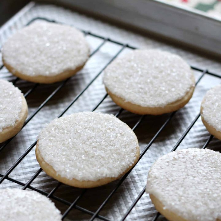 Sugar cookies with sprinkles on a wire cooling rack