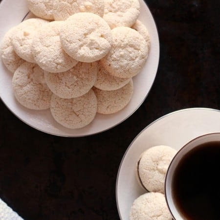 Ameretti biscuits piled on a white plate