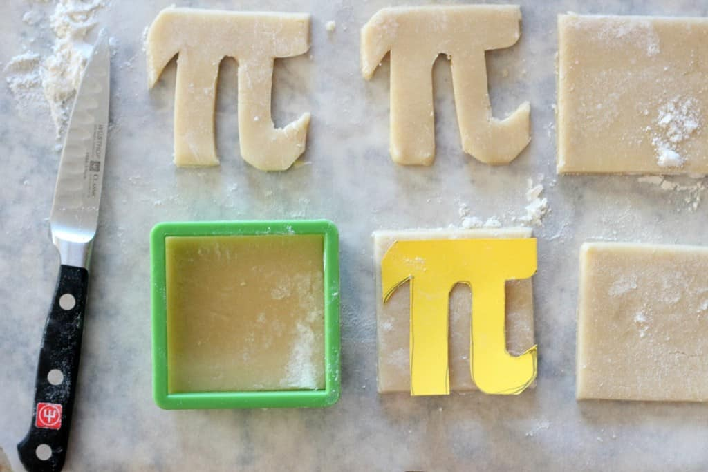 pi cookie template and raw cookie dough in the shape of Greek letter Pi