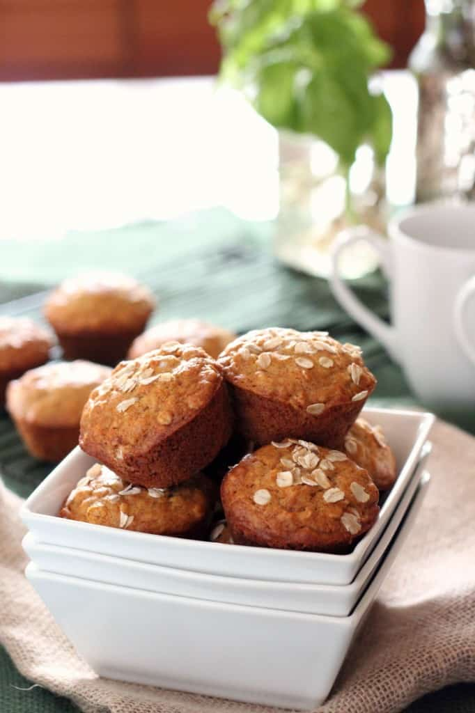 honey oatmeal muffins piled in a square white serving dish