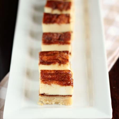 Churros cheesecake squares on a plate
