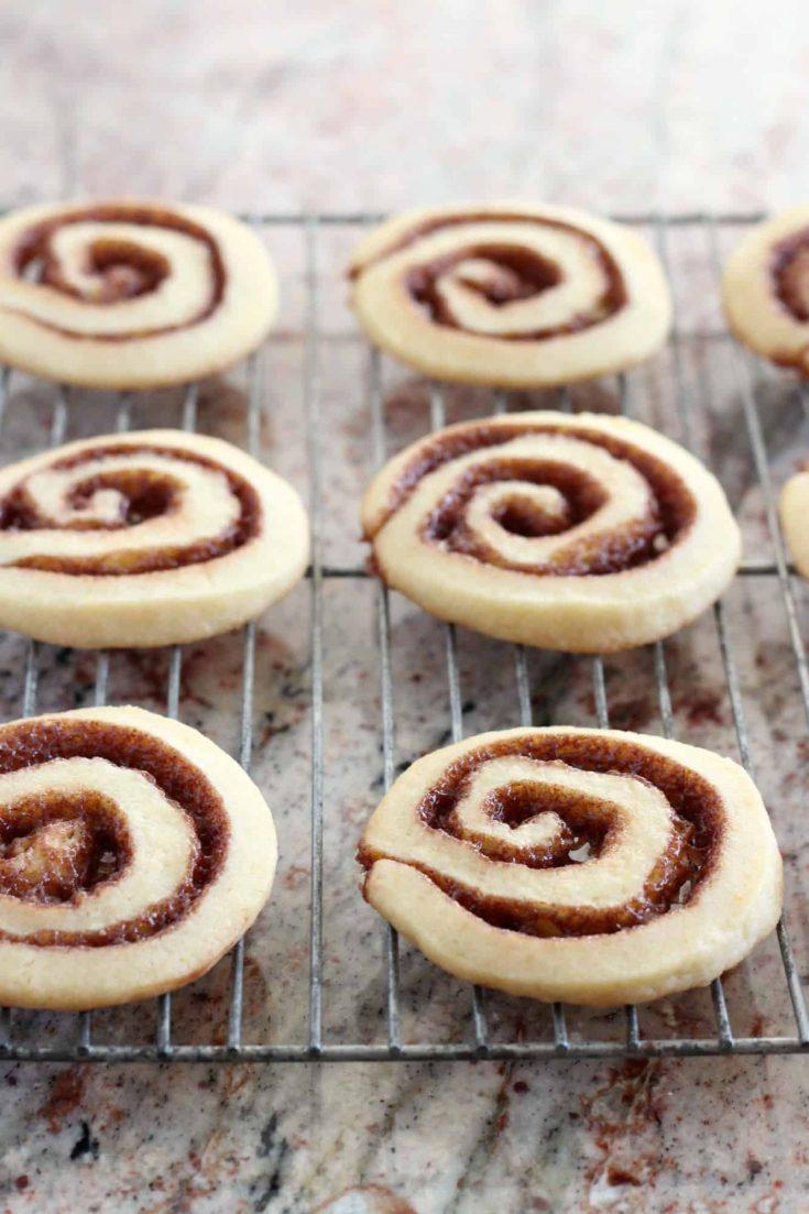 Cinnamon Roll Cookies are a playful recipe that gives you the swirl of a cinnamon roll in a cookie bite. #abakershouse #cinnamonrolls #cinnamoncookies #sliceandbake