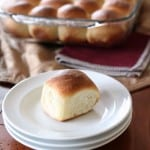 One bread roll on white plate